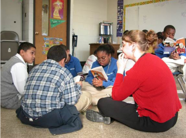Susan Larson planned to leave after a few years at KIPP, but stayed because of bonds formed with students. Here she reads with a group of students in the school's early years. (Photo provided by KIPP Philadelphia Schools)