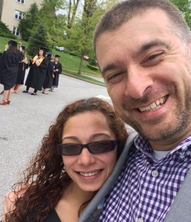 Student and former principal pose for a selfie after Zuleika Roman earns her associate's degree in 2016. (Photo provided by Zuleika Roman)