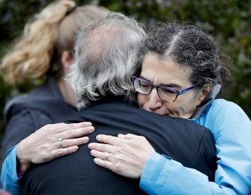 People embrace along the street in the Squirrel Hill neighborhood of Pittsburgh where a shooter opened fire during services at the Tree of Life Synagogue on Saturday, Oct. 27, 2018. (Keith Srakocic/AP Photo)