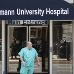 A person exits Hahnemann University Hospital in Philadelphia, Wednesday, June 26, 2019. (Matt Rourke/AP Photo)