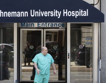 A person exits Hahnemann University Hospital in Philadelphia, Wednesday, June 26, 2019. The owner of hospital has announced it will close in September because of what the company calls
