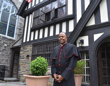 The Very Rev. Canon Martini Shaw stands outside of the African Episcopal Church of St. Thomas. (Ronald Gray/The Philadelphia Tribune)