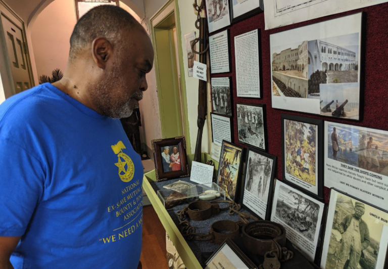'All this stuff touches home. It doesn't go back that far,' says Germantown resident Mark Keenheel as he looks at items in the Lest We Forget Museum of Slavery recently in August. (Michael D'Onofrio/The Philadelphia Tribune)