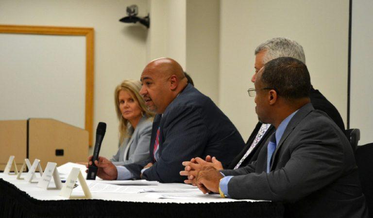 Department of Corrections Secretary John Wetzel, center, talks to reporters Aug. 28, 2019. (Brett Sholtis/WITF)