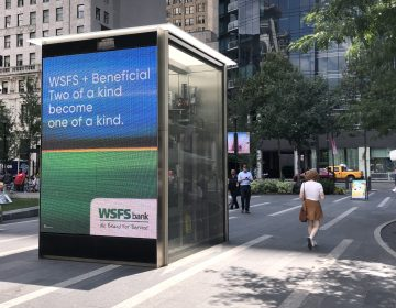 One of the many billboards used to announce the change of Beneficial Bank branches to WSFS Bank.  This one is in Dilworth Park in Center City.  The change will be complete on Monday, Aug. 26. (P. Kenneth Burns/WHYY)