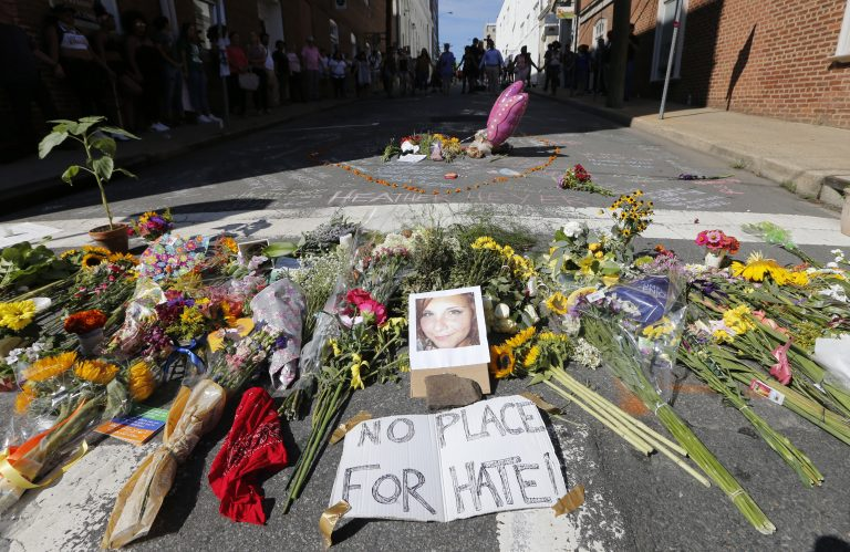 A makeshift memorial of flowers and a photo of victim Heather Heyer sits in Charlottesville, Va., on Aug. 13, 2017. Heyer died when a car rammed into a group of people who were protesting white supremacists who had gathered in the city for a rally. (Steve Helber/AP Photo)
