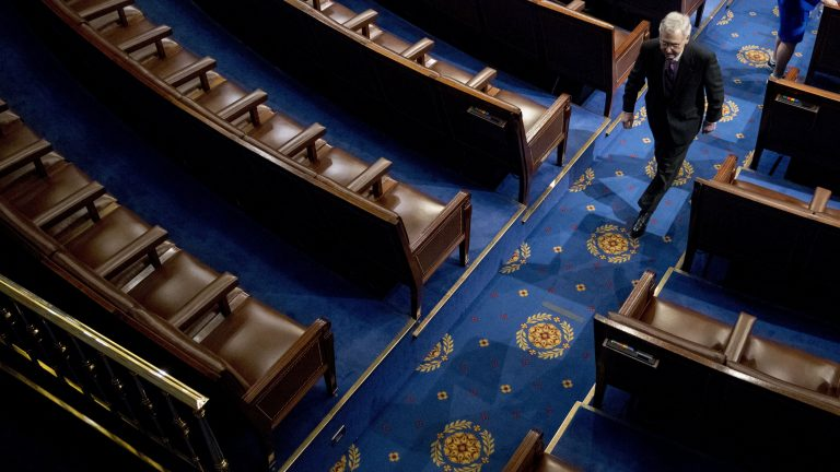 Senate Majority Leader Mitch McConnell of Kentucky walks off the House floor in April. In his chamber, McConnell can decide virtually by himself what the Senate will do — and even what it will consider doing. (Andrew Harnik/AP Photo)