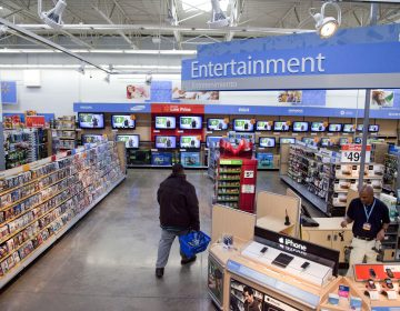 Walmart has instructed employees to remove marketing material that displays violent imagery and to unplug or turn off video game consoles that show violent games. (AP Photo)