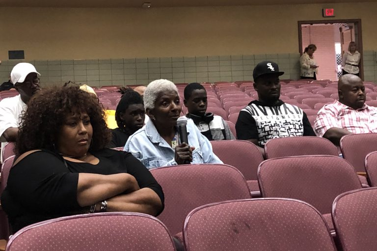A woman who lives near the Croda chemical plant questions company and state officials during a meeting about November's toxic release and steps being taken before the plant can resume making ethylene oxide. (Cris Barrish/WHYY)