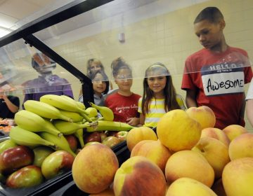 Students select food items from the lunch line of the cafeteria at Draper Middle School in Rotterdam, N.Y. (AP Photo/Hans Pennink)