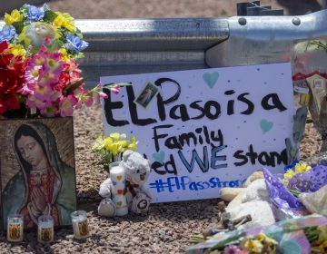 Flowers and a Virgin Mary painting adorn makeshift memorial for the victims of Saturday mass shooting at a shopping complex in El Paso, Texas, Sunday, August 4, 2019. (Andres Leighton/AP Photo)