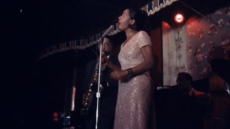 Billie Holiday performs on stage at the Sugar Hill nightclub in Newark, N.J. Farah Jasmine Griffin's 2001 book posed a challenge to biographers and helped reimagine Holiday's legacy. (Bob Parent/Getty Images)