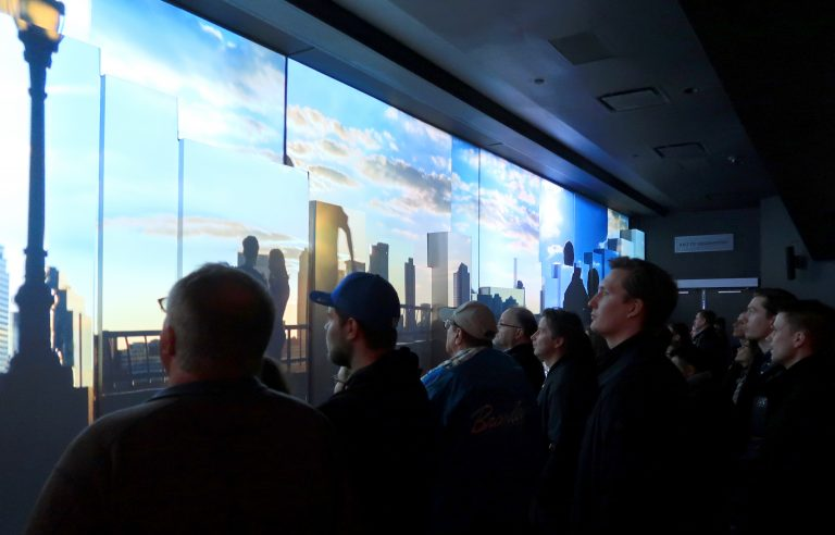 At One World Trade Center in 2017, visitors watch a movie at the New York City building's observatory. Now there's a new feature: A scent meant to complement the multimedia experience. (Gary Hershorn/Getty Images)