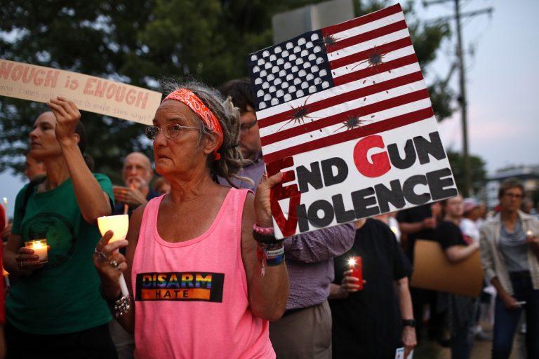 Sandi Lisko attends a vigil for recent victims of gun violence outside the National Rifle Association's headquarters building, Monday, Aug. 5, 2019, in Fairfax, Va. (AP Photo/Patrick Semansky)