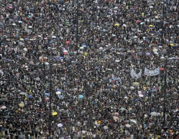 Protesters gather on Victoria Park in Hong Kong on Sunday, Aug. 18, 2019. Thousands of people streamed into a park in central Hong Kong on Sunday for what organizers hope will be a peaceful demonstration for democracy in the semi-autonomous Chinese territory. (AP Photo/Kin Cheung)