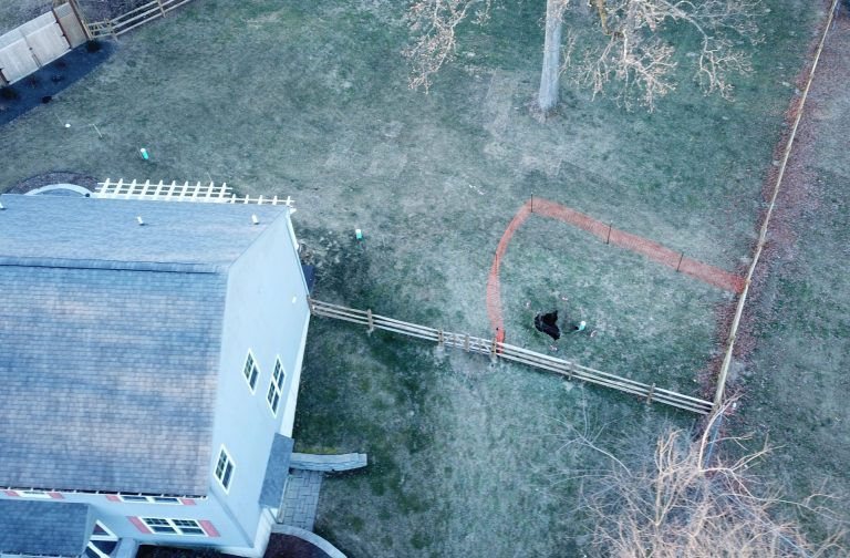 A sinkhole that opened up in January was surrounded by orange plastic fencing outside a suburban home at Lisa Drive in West Whiteland Township, Chester County. (Courtesy of Eric Friedman)
