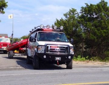 In this August 2014 file photo, a Seaside Heights water rescue truck departs the Governor's Mansion in Island Beach State Park. (Photo: Justin Auciello/for WHYY)