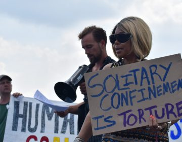 Members of the group Human Rights Coalition speak at a rally Friday, Aug. 2, 2019 at Department of Corrections headquarters in Mechanicsburg, Cumberland County. (Brett Sholtis/WITF)