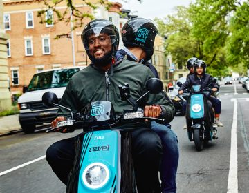 Riders cruise through Brooklyn on Revel mopeds. (Courtesy of Revel)