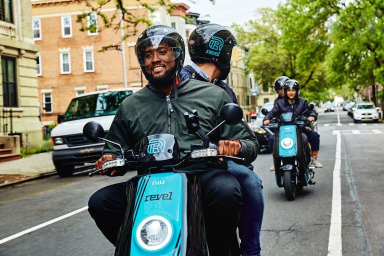 Riders cruise through Brooklyn on Revel mopeds. (Courtesy of Revel)