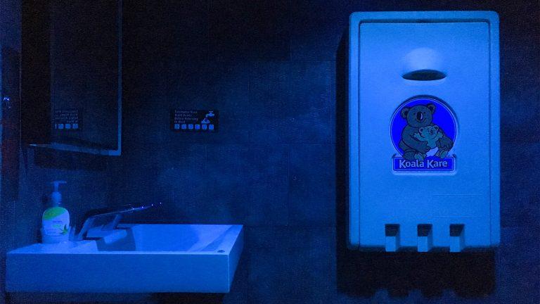 Blue lights bathe the bathroom at a Center City Starbucks (Michaela Winberg/Billy Penn)