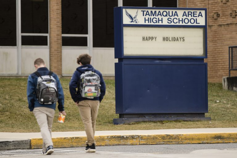 Students walk to Tamaqua Area High School in Tamaqua, Pa., Friday, Jan. 4, 2019. Parents are going to court to block the Pennsylvania school district from allowing teachers to carry guns in school. (AP Photo/Matt Rourke)