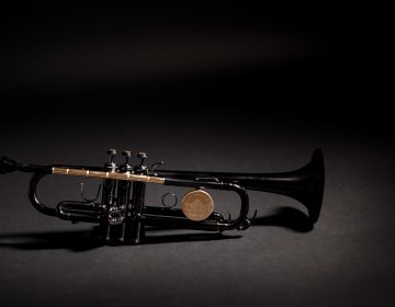 The Instrument of Hope is lacquered in black except for the shiny brass parts, which are clear lacquered. They include the lead pipe, which is made from bullets set end to end and drilled out so that air can flow through to make it a playable instrument. The tops of the three buttons are made of the sawn-off casing end caps or rims. (Matt Mckay/Publicis North America)