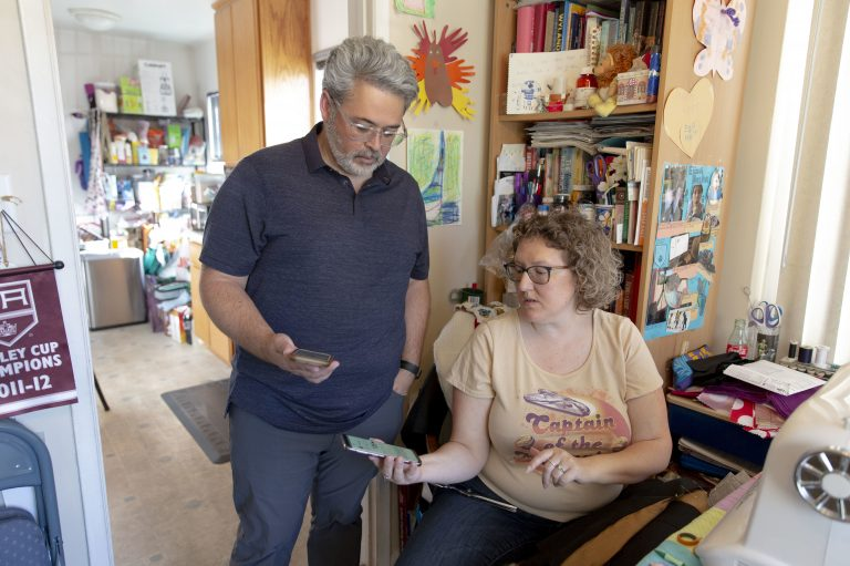 Ric Peralta and his wife Lisa are both able to check Ric's blood sugar levels at any time, using the Dexcom app and an arm patch that measures the levels and sends the information wirelessly. (Allison Zaucha for NPR)