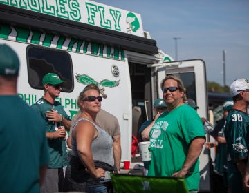 Craig Thomas (center right, pictured in 2019) comes from Maryland for every home game in his big Eagles van. Once at the stadium, friends flood his van for his traditional tailgate. (Emily Cohen for WHYY)