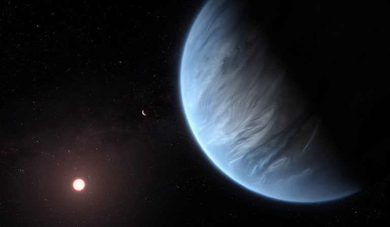 This artist's impression shows the planet K2-18b, its host star and an accompanying planet in this system. By ESA/Hubble, M. Kornmesser