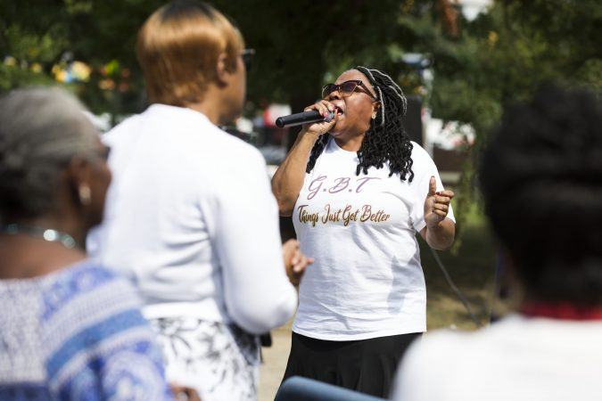 Evangelist Brenda Rogers leads prayer during Sunday morning services at the Greater Bible Way Temple on Sept. 1, 2019. (Rachel Wisniewski for WHYY)