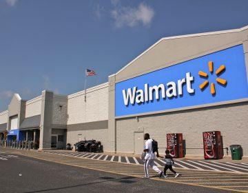 Customers leave a Walmart in Blackwood, N.J.  (Emma Lee/WHYY)
