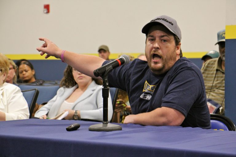 Refinery employee Shawn Tolomeo argues that the Philadelphia Energy Solutions property in South Philadelphia should remain a refinery. (Emma Lee/WHYY)
