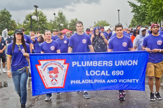 Members of the Plumbers Union march in Philadelphia's 2019 Labor Day Parade. (Kimberly Paynter/WHYY)