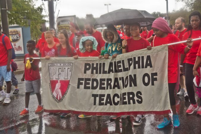 Family members join PFT union workers during the 2019 Labor Day Parade. (Kimberly Paynter/WHYY)