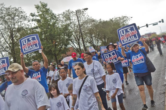 The National Association of Letter Carriers marches in the 2019 Philadelphia Labor Day Parade. (Kimberly Paynter/WHYY)