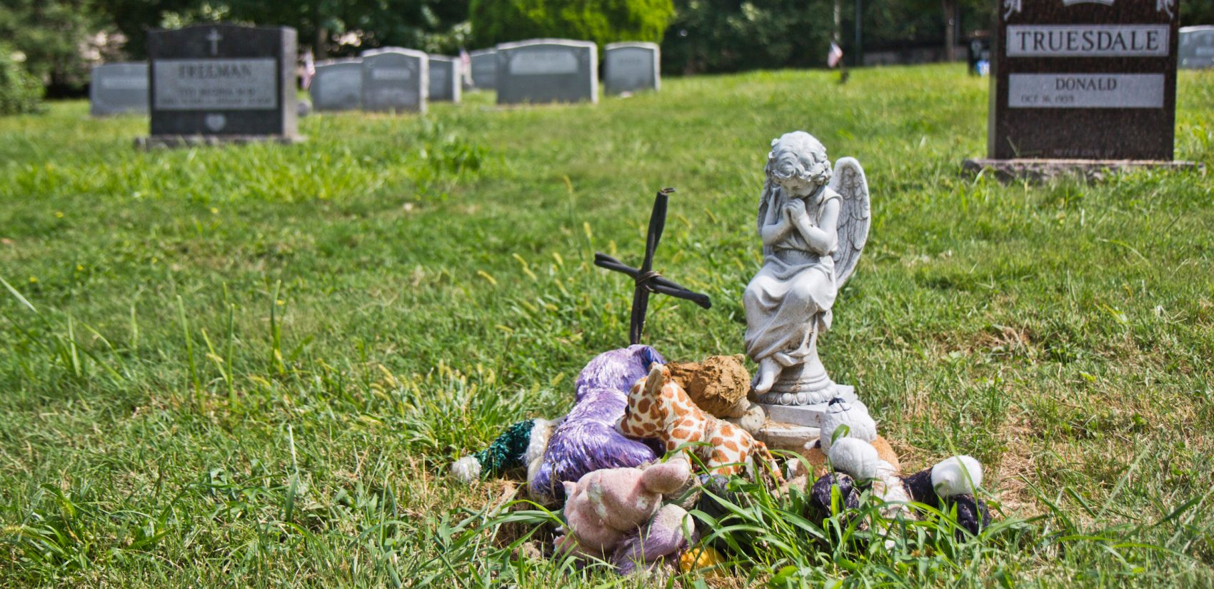 Items brought by visitors to the burial site of the