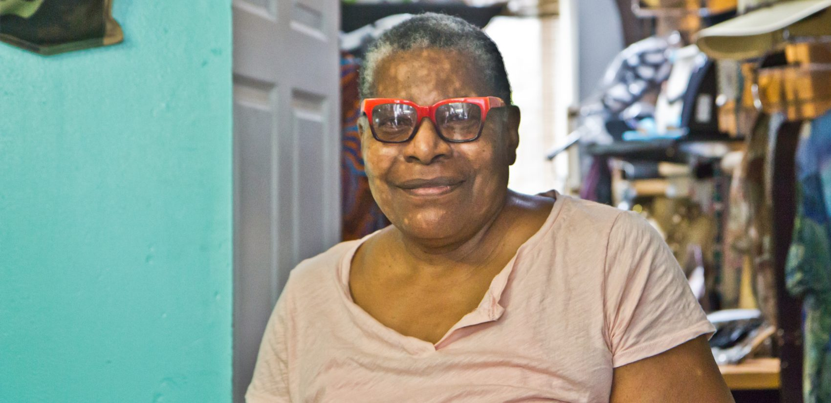 Phyllis Carter is the owner of a consignment shop on Lancaster Avenue. She'd like the former clinic building to become something totally unrelated to reproductive health. (Kimberly Paynter/WHYY)