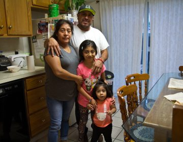 Zenaida Bautista, Jose Cabañas, and their daughters Jannet and Audrey, at their home in Ambler. (Kimberly Paynter/WHYY)
