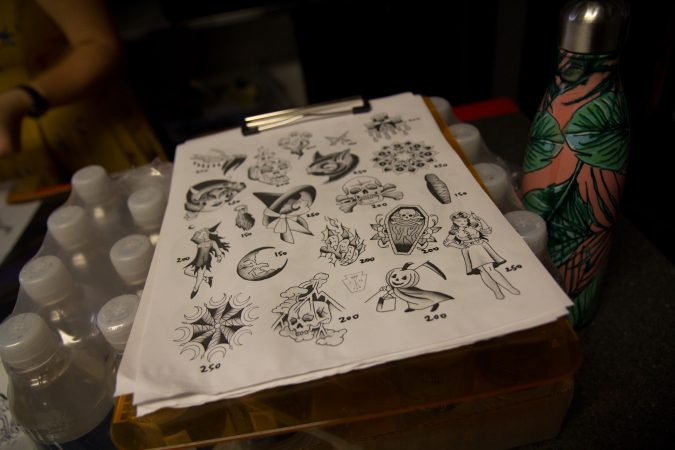 Tattoo options for the Friday the 13th free tattoo give away at Eastern State Penitentiary. (Kimberly Paynter/WHYY)