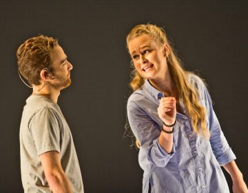 Theo Huffman and Siena Licht Miller perform in Denis and Katya, playing multiple characters examining the aftermath of two teenagers that live-streamed the events that led up to their deaths. (Kimberly Paynter/WHYY)