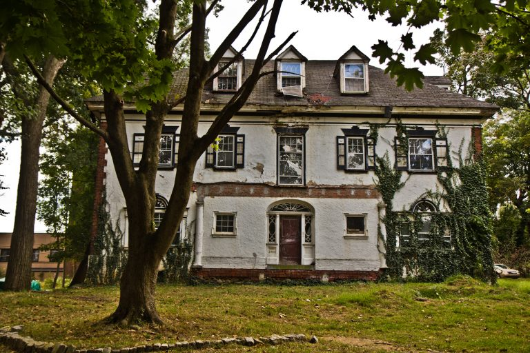 A historic home in need of repair on Upland Way in Overbrook. (Kimberly Paynter/WHYY)