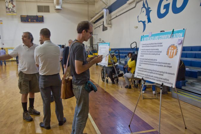At the city's last community meeting about the refinery, citizens were invited to comment on findings with sticky notes. (Kimberly Paynter/WHYY)