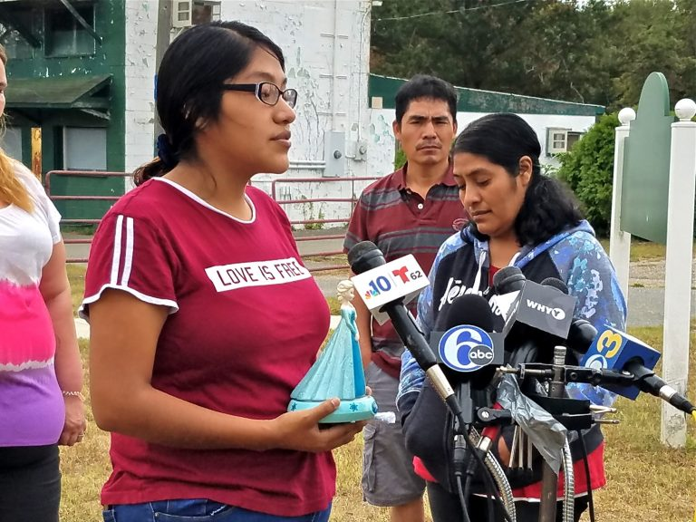 Noema Alavez Perez (left), mother of missing 5-year-old Dulce Maria Alavez, holds her daughter's favorite toy as she speaks to reporters at the Bridgeton City Park.  She is accompanied by her mother, Norma Perez (right). (Nicholas Pugliese/WHYY)