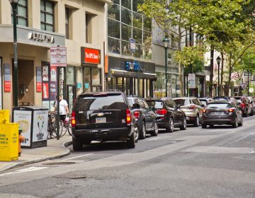 Cars double parked on the 1200 block of Chestnut St. (Kimberly Paynter/WHYY)