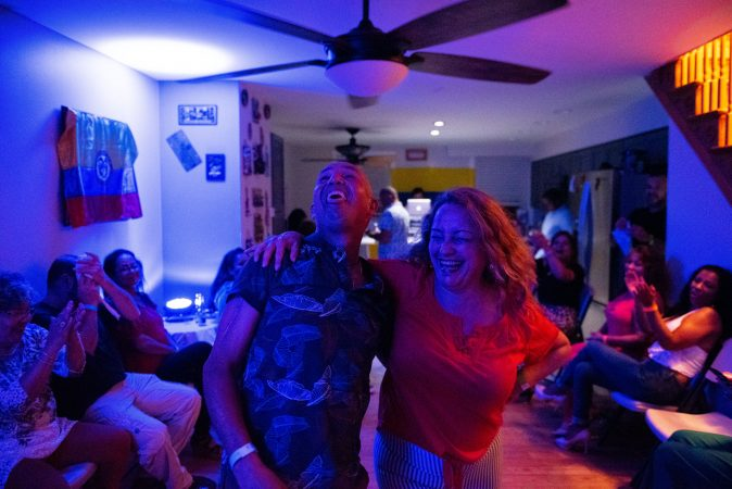 Liiana Acero dances with Eduardo Bru during the at-home vijoteca on Saturday, September 14, 2019. (Kriston Jae Bethell for WHYY)