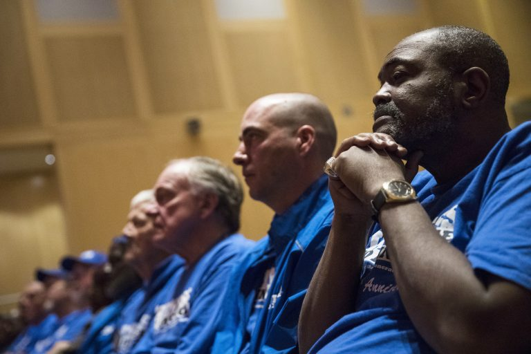 Death row exonerees including Kwame Ajamu, (right), listens to speakers during a Witness to Innocence news conference marking the organization's 15th anniversary at the at the National Constitution Center in Philadelphia, Thursday, Nov. 15, 2018. (Matt Rourke/AP Photo)