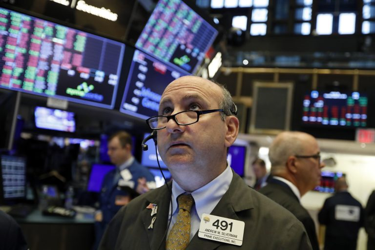 In this Tuesday, Aug. 13, 2019, file photo trader Andrew Silverman works on the floor of the New York Stock Exchange. The threat of a recession doesn't seem so remote anymore, and stocks sank Wednesday after the bond market threw up one of its last remaining warning flags on the economy's health. (AP Photo/Richard Drew, File)