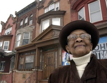 "This 2003 photo shows Mary Alexander, John Coltrane's cousin, in front of the John Coltrane house in Philadelphia. Jazz giant John Coltrane's cousin, who inspired the composition ""Cousin Mary"" from his landmark album ""Giant Steps,"" has died in Philadelphia. Mary Lyerly Alexander was 92. Carla Washington of Philadelphia's Clef Club who is a friend of the family says Alexander died Aug. 31, 2019. (Akira Suwa/The Philadelphia Inquirer via AP)"