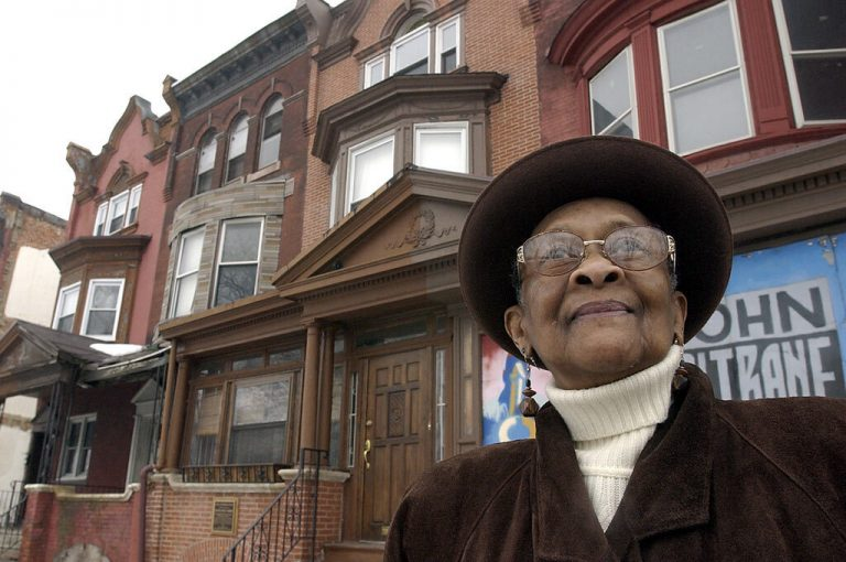 """This 2003 photo shows Mary Alexander, John Coltrane's cousin, in front of the John Coltrane house in Philadelphia. Jazz giant John Coltrane's cousin, who inspired the composition """"Cousin Mary"""" from his landmark album """"Giant Steps,"""" has died in Philadelphia. Mary Lyerly Alexander was 92. Carla Washington of Philadelphia's Clef Club who is a friend of the family says Alexander died Aug. 31, 2019. (Akira Suwa/The Philadelphia Inquirer via AP)"""